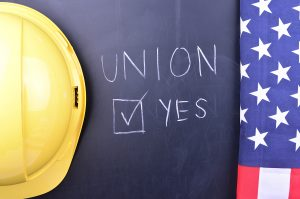 Hard hat and flag on chalk board that says Union
