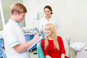 Female patient discussing cosmetic dentistry services with dentist